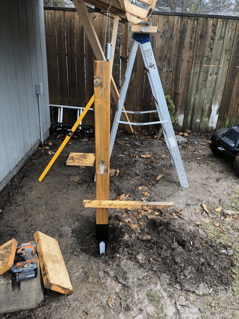 using a pendulum weight to locate the posts on a simple diy carport shed
