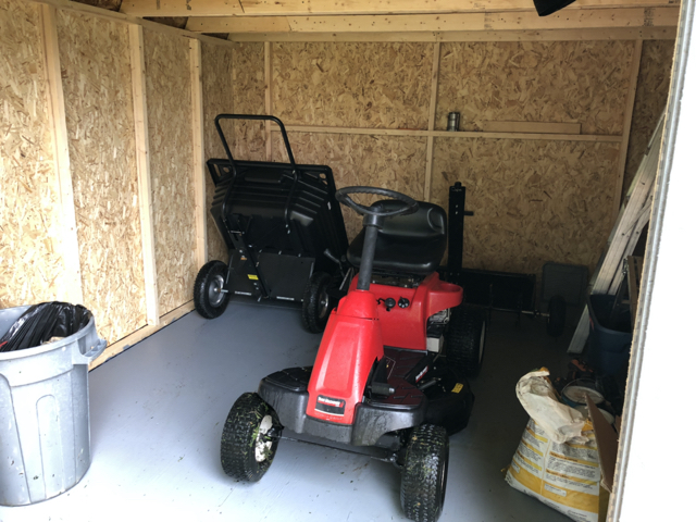 Large barn style storage shed to store yard maintenance equipment