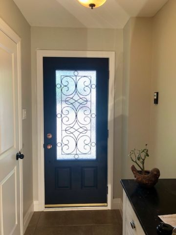 Flat Black Front Door with Gold Accents