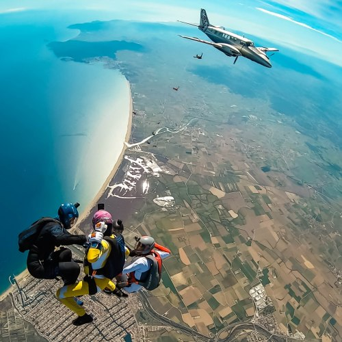 Skydiving Head up world record exit picture by Augusto Bartelle