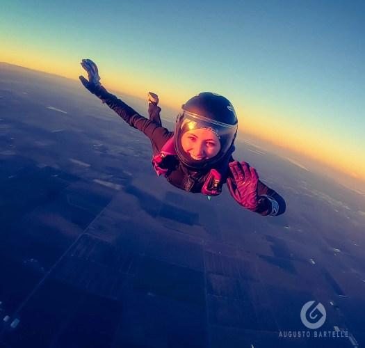 Skydiving girl smiling during free fall in California