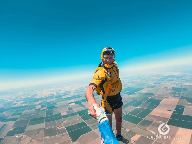 Olav Zippier flying with his yellow jumpsuit