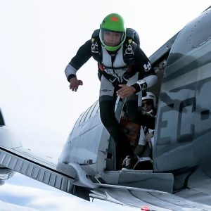 skydiver jumping out of an airplane