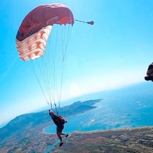 Parachute flying over ocean