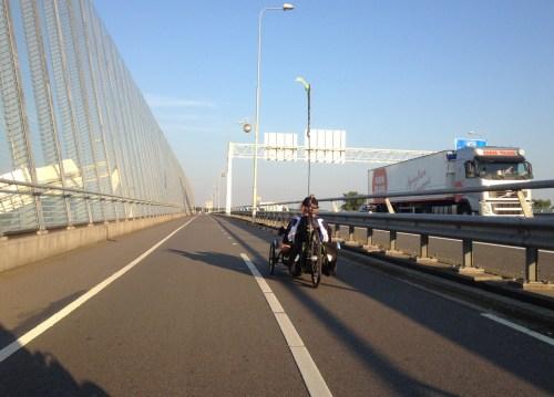 Trikes and traffic crossing Venlo bridge