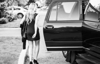 woman going in car