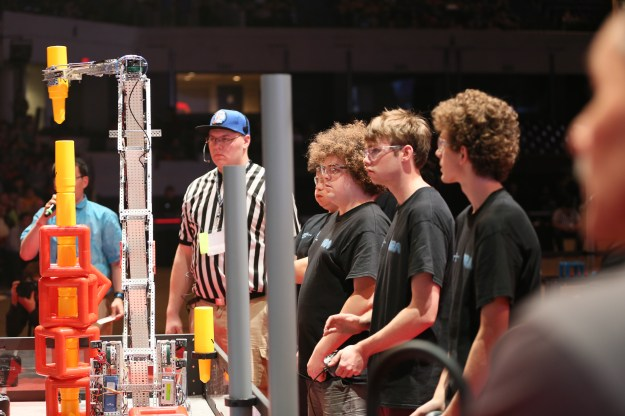 Our Worlds team watches the robots perform autonomously during the finals.