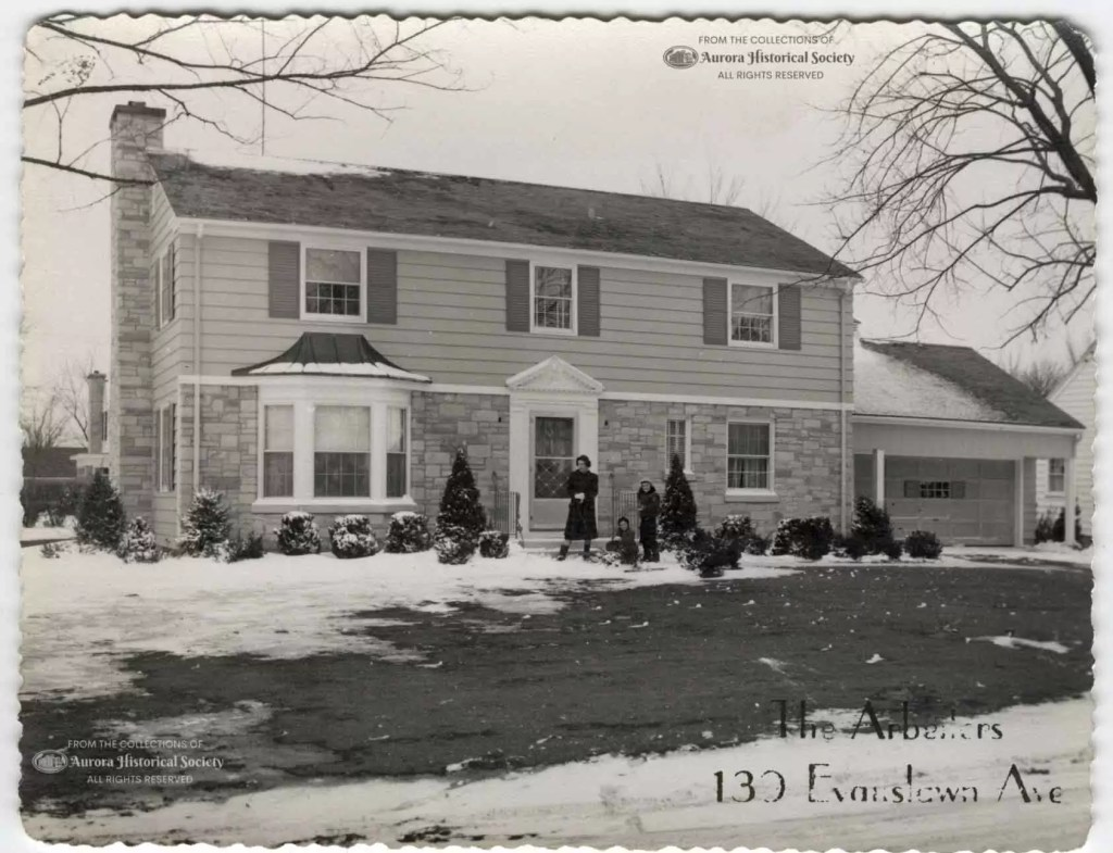 Christmas card of George & Lois Arbeiter showing their children Janice, Judy, and George in front of their home at 139 S. Evanslawn early or mid-1950s (Aurora Historical Society Photo)