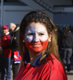 A Chilean girl showing her national colors