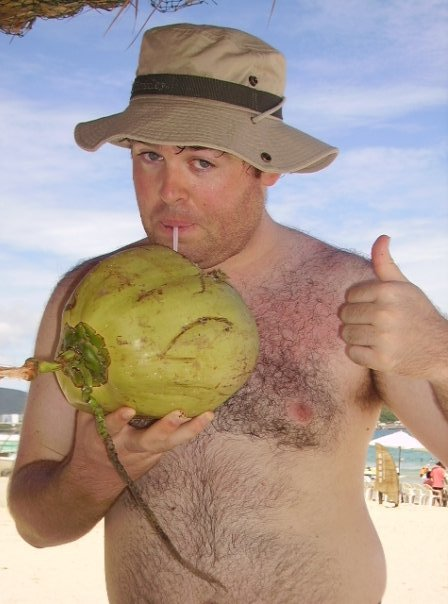 Enjoying a coconut on the beach in Hainan, China