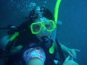 Mel poses while scuba diving