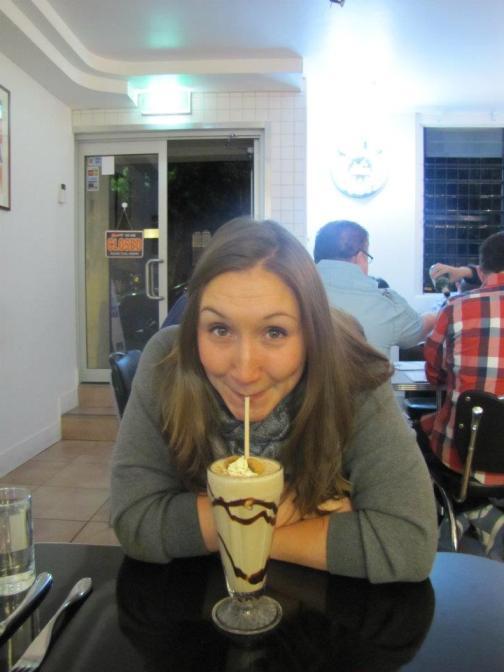Annie sipping on her chocolate milkshake