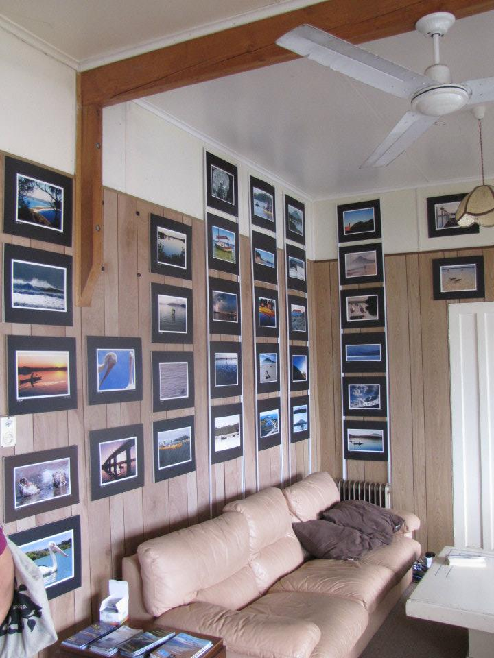 Larry's photography on display in the lounge room