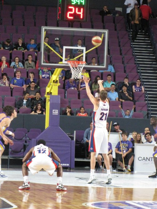 An Adelaide 36ers player nails a three point shot