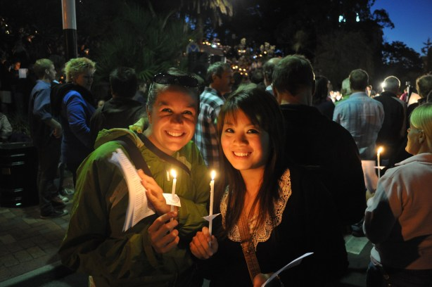 Two girls attend Carols by Candlelight in Nelson, New Zealand