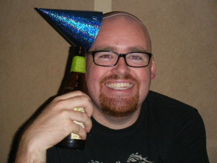 bald man in a party hat