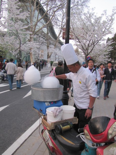 A cotton candy vendor does brisk business on a spring day in Nanjing