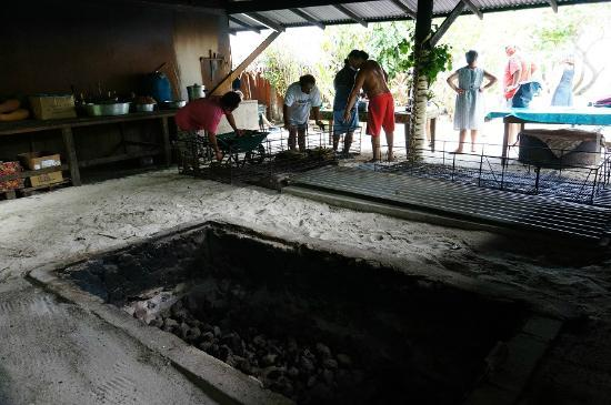 It's a hungi, bru! The pit ready to be filled with potatoes and meat.