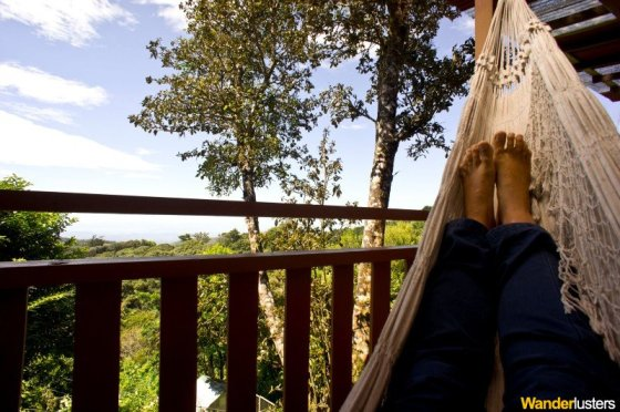 Relaxing in a hammock while on the job in Costa RIca.