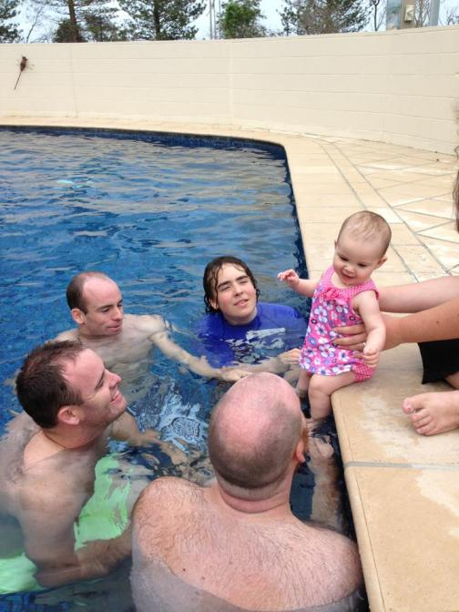 My brothers and I lavish our niece, Ally, with attention.