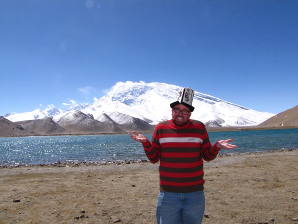 Rocking my new hat on the shores of Lake Karakul in Xinjiang.