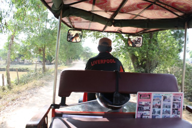 Our tuk tuk takes us down a back road to find the gun range.