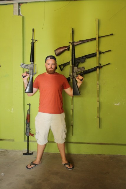 I channel Rambo as I pose with a pair of M16s.