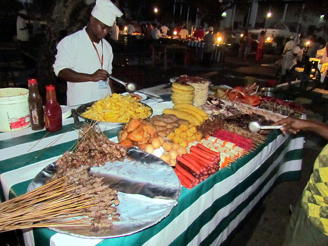 A vendor at Forodhani Gardens in Stone Town. Photo by David Berkowitz.