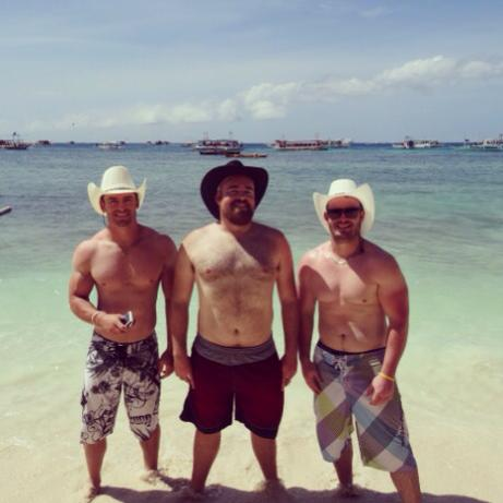 My brothers and I living the dream on a beach in the Philippines.