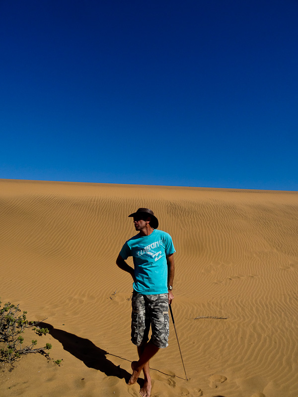 Chris cuts a dramatic figure as he explains to us how the desert lives an breathes.