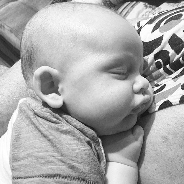 Adorable baby boy in black and white