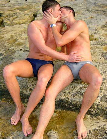 2 guys kissing in their speedos.