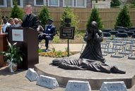 JESUS WEPT: Cardinal Blase Cupich speaks to an audience about the new art piece Thou Shalt Not Kill, pictured to the right, last Thursday, during a dedication ceremony in the Father Augustus Tolton Peace Center at Catholic Charities in Austin. | ALEXA ROGALS/Staff Photographer
