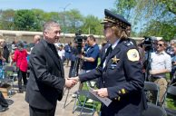 Cardinal Blase Cupich, left, greets Chicago Police commander Susan Moss last Thursday, during a dedication ceremony in the Father Augustus Tolton Peace Center at Catholic Charities in Austin. | ALEXA ROGALS/Staff Photographer