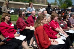 Attendees sit and listen to speakers last Thursday, during a dedication ceremony in the Father Augustus Tolton Peace Center at Catholic Charities in Austin. | ALEXA ROGALS/Staff Photographer