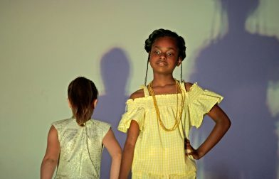 """Participants dress up in different clothes with the color yellow during the """"Lemonade"""" portion of the show last Friday, during the annual Exclusive Spring Fashion Show inside the auditorium at Ella Flagg Young Elementary School in Chicago's Austin neighborhood. 