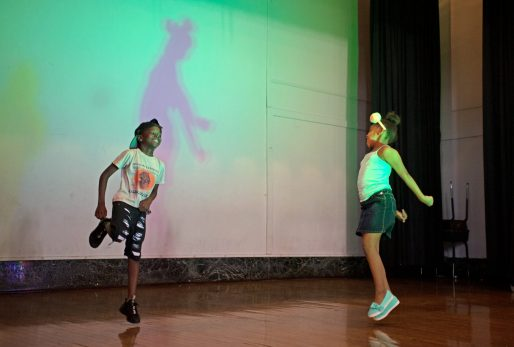 Kids go up on stage and dance to music between each run last Friday, during the annual Exclusive Spring Fashion Show inside the auditorium at Ella Flagg Young Elementary School in Chicago's Austin neighborhood. | Photos by ALEXA ROGALS/Staff Photographer