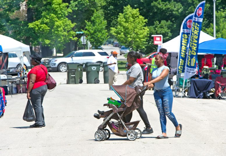 Fest-goers walk around the area and check out the different stands and food trucks throughout the park last Saturday, during the West Side's Juneteenth Celebration at Garfield Park. | ALEXA ROGALS/Staff Photographer