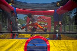 Children jump around together in a bounce house last Saturday, during the West Side's Juneteenth Celebration at Garfield Park. | ALEXA ROGALS/Staff Photographer