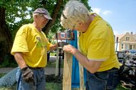 Rebuilding together: Dave Gemperline, left, and Bob Spence, put up a new fence last Thursday, during a Rebuilding Together home renovation project in Homan Square. | By ALEXA ROGALS/Staff Photographer
