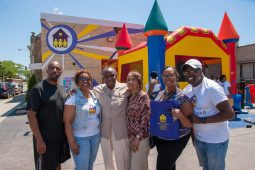 ALL IN THE FAMILY: Hicks celebrates on July 7 in Oak Park with her parents, Robert, fourth from right, and Genevia Williams Sr., and her siblings. Hicks' late mother-in-law, Lilla Hicks, started ABC Toon Town as a homecare provider. The center's clientele is multiracial. | SHANEL ROMAIN/Contributor