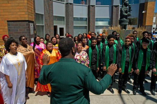 Members of HHW Vocal Arts Ensemble, above, perform last Wednesday, outside of the Westside Health Authority on Chicago Avenue in Austin. The ceremony was sponsored by State rep. La Shawn K. Ford. | ALEXA ROGALS/Staff Photographer