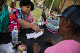 Andrea Oden, left, teaches Annie Lloyd how to make teddy bears out of hand towels last Saturday, during the Awesome Austin Art Affair on West End and Mayfield Avenues in Austin. | Photos by ALEXA ROGALS/Staff Photographer