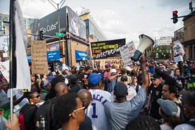 Protesters rally outside of Wrigley Field on Thursday, during an anti-violence protest in Chicago. | ALEXA ROGALS/Staff Photographer