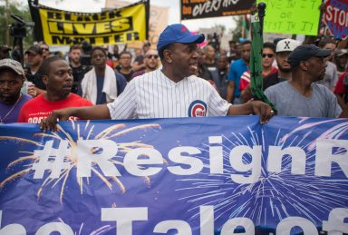 Rev. Ira Acree marches with protesters on Lake Shore Drive on Thursday, during an anti-violence protest in Chicago. | ALEXA ROGALS/Staff Photographer