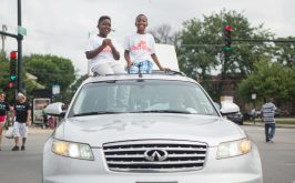 Kids ride in the Prevention Partnership vehicle last Saturday, during Congressman Danny Davis' annual Back 2 School parade on Central Avenue in Chicago's Austin neighborhood. | Photos by ALEXA ROGALS/Staff Photographer