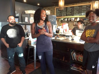 SHE'S RUNNING ... LITERALLY: Mayoral candidate Amara Enyia had been running with community members and holding public discussions across the city in the months and weeks ahead of her formal announcement last week. Above, she's in a cafe in Back of the Yards. | AMARA ENYIA/Facebook