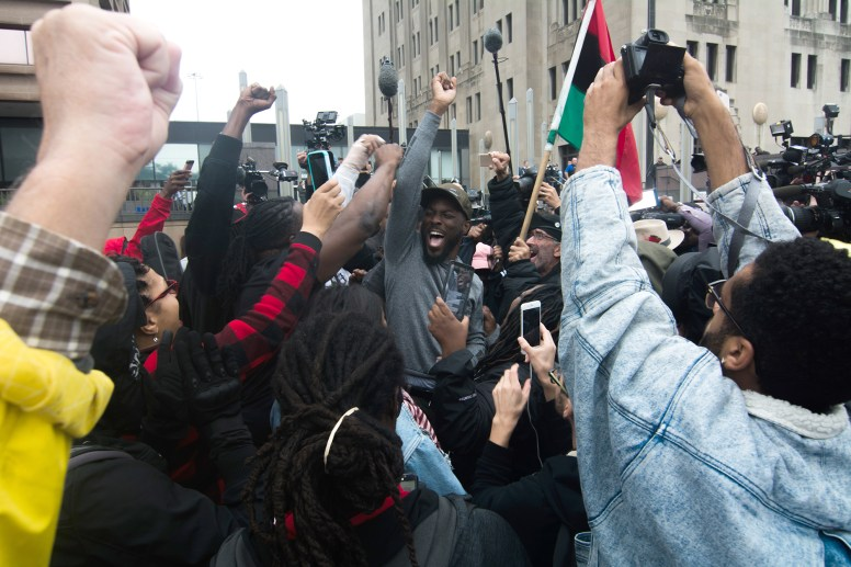 "JUSTICE DELAYED: Almost immediately after Jason Van Dyke was found guilty of second-degree murder and detained without bond, a crowd of activists outside of the Cook County courthouse erupted into chants of ""Justice for Laquan!"" McDonald was murdered four years ago. 