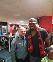 Former Chicago Bear Israel Idonije pairing up with Officer Martinez during the district's Shop with a Cop event. | Photos courtesy 15th District Police