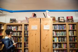 A customer looks through books for sale on Wednesday, Dec. 12, 2018, at Jake's Place Bookstore on Harrison Street in the Arts District in Oak Park, Ill. | ALEXA ROGALS/Staff Photographer